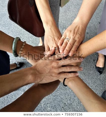 muitos · mãos · luz · trabalhar · mulher - foto stock © jayfish