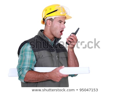 Tradesman yelling into a walkie-talkie Stock photo © photography33