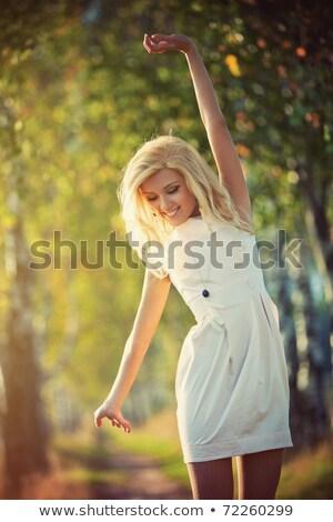 skittish young blond woman stock photo © acidgrey