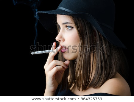 Stock photo: Portrait of the cute woman with a cigarette