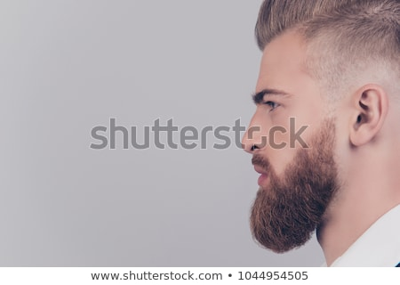 man shaving isolated on red background stock photo © massonforstock