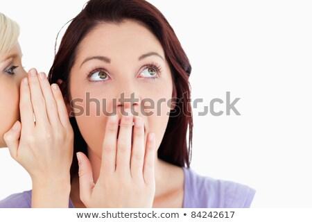 Close up of a cute women being told a secret in a studio stock photo © wavebreak_media