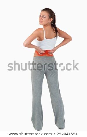 背面図 女性 腰痛 白 手 スポーツ ストックフォト © wavebreak_media