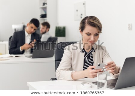 Professional businesswoman receiving a customer in her office Stock photo © wavebreak_media