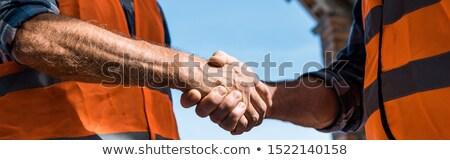 Hands against blue sky Stock photo © joseph73