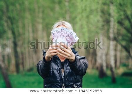 jonge · vrouw · geld · dollar · hand - stockfoto © wavebreak_media