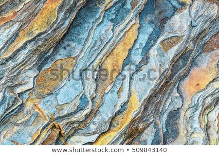 Interessante rock uccello battenti cielo blu intemperie Foto d'archivio © jrstock