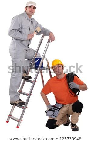 Schilder ladder hurken elektricien man bouw Stockfoto © photography33