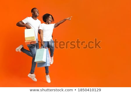 orange guy with shopping bag stock photo © kirill_m