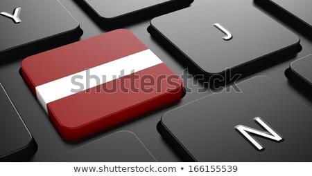 Letonya bayrak düğme siyah klavye bilgisayar klavye Stok fotoğraf © tashatuvango