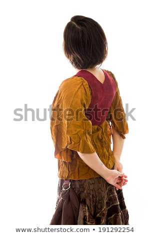Rear view of a young woman standing with her hands clasped Stock photo © bmonteny