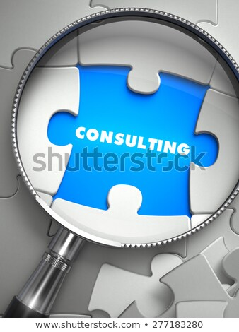consulting   puzzle with missing piece through loupe stock photo © tashatuvango