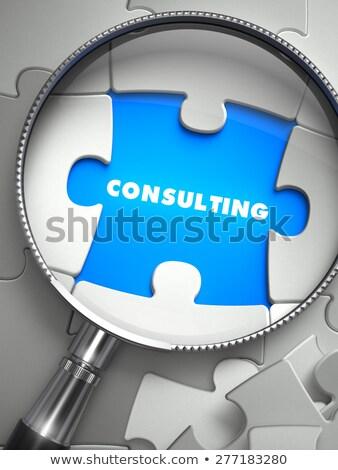 Consulting - Puzzle with Missing Piece through Loupe. Stock photo © tashatuvango