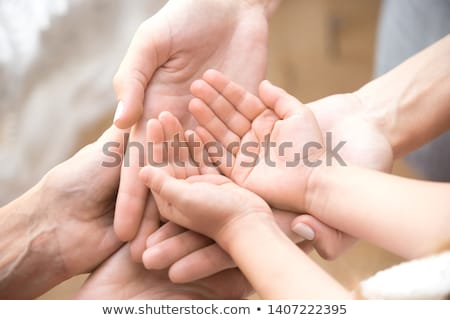 The connected hands of family as support and unity sign. Three people on nature. Stock photo © Paha_L