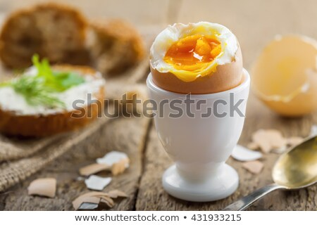 Boiled eggs in eggcups and white bread Stock photo © Digifoodstock