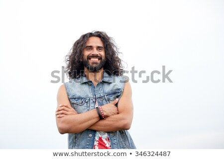 smiling young hippie man in demin vest Stock photo © dolgachov