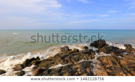 waves breaking on a stony beach Stock photo © Klinker