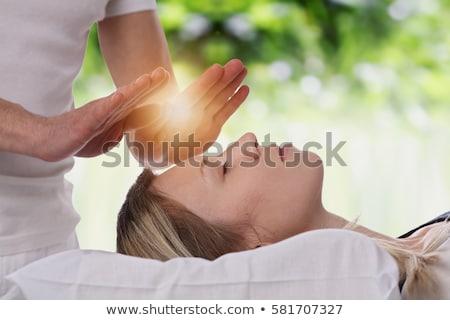 Young woman having a reiki treatment Stock photo © wavebreak_media