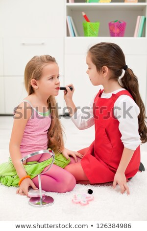 Girl paints her lips with red lipstick, makeup Stock photo © studiostoks