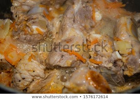 Fresh onion quarters in a pan Stock photo © Digifoodstock