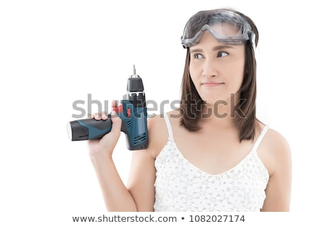 woman holds a drill stock photo © nobilior