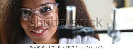 Kadın kimyager örnek beyaz bilim laboratuvar Stok fotoğraf © bluering