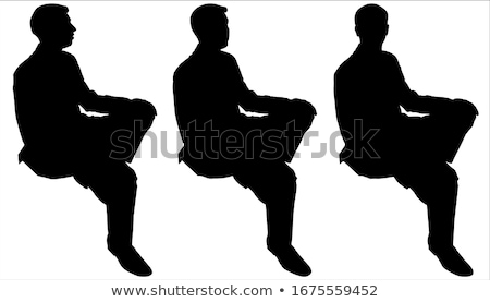 seated happy business man holding hands on knees Stock photo © feedough
