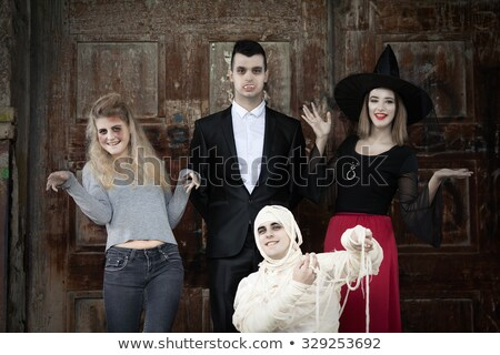 Heureux gothique femme sorcière halloween costume Photo stock © deandrobot