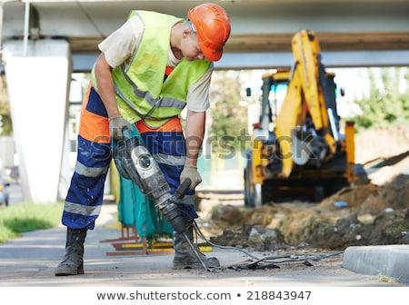 Trabalho duro asfalto construção homens trabalhando estrada Foto stock © zurijeta