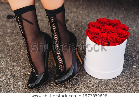 Woman legs wearing black high heels Stock photo © Nobilior