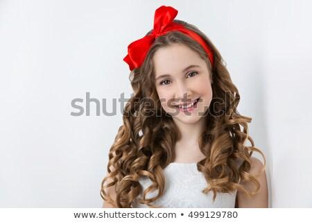 meglepődött · fiatal · vicces · lány · íj · hajviselet - stock fotó © victoria_andreas