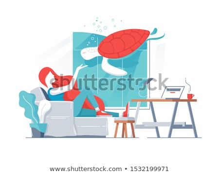 Girl in office with turtle in aquarium Stock photo © Filata