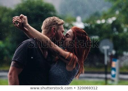 Belo casal beijando chuva fora menina Foto stock © tekso