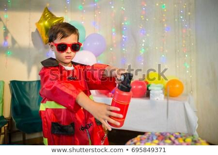 Aranyos fiú tűzoltó születésnapi buli otthon ház Stock fotó © wavebreak_media