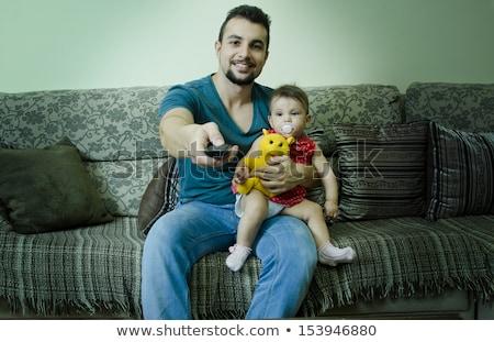 Bebek izlerken baba aile sevmek Avrupa Stok fotoğraf © IS2