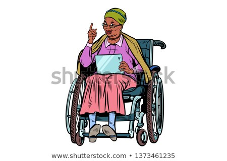 elderly african woman disabled person in a wheelchair gadget ta stock photo © studiostoks