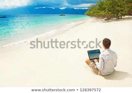бизнесмен расслабляющая ноутбука за пределами бизнеса саду Сток-фото © IS2