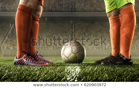 Football players playing soccer in the ground Stock photo © wavebreak_media