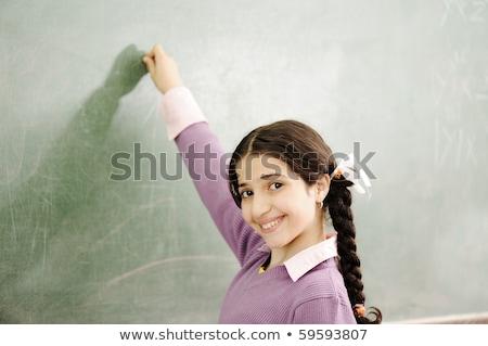 prachtig · meisje · schrijven · klas · boord · hand - stockfoto © zurijeta