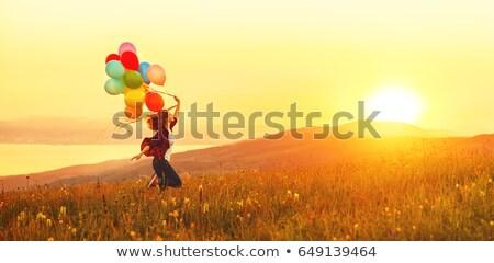 Kız atlama hava balonlar özgürlük balon Stok fotoğraf © IS2