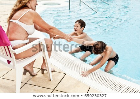 2 boys coaxing grandmother into pool Stock photo © IS2