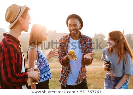Genç adam şişe soda taze Stok fotoğraf © RAStudio