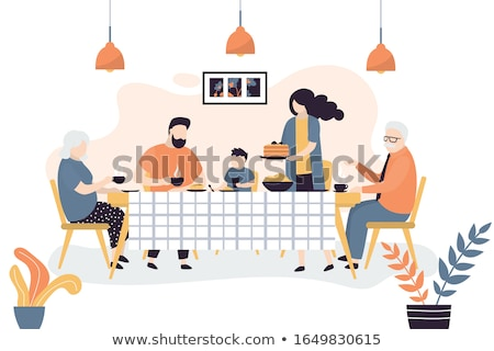 Family sitting at kitchen table eating Stock photo © IS2
