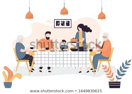 Famiglia seduta tavolo da cucina mangiare alimentare sedia Foto d'archivio © IS2