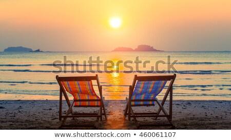 Espreguiçadeira pôr do sol salão tabela dois óculos Foto stock © tracer