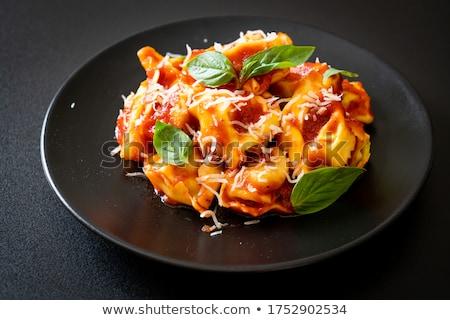 Ravioli paradicsomszósz parmezán bazsalikom étel ebéd Stock fotó © M-studio