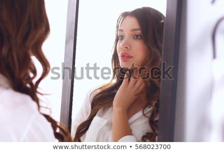 Mulher roupa interior olhando espelho manhã beleza Foto stock © dolgachov