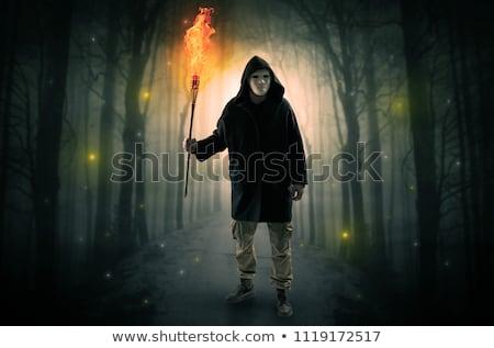 Titokzatos férfi út erdő izzó lámpás Stock fotó © ra2studio