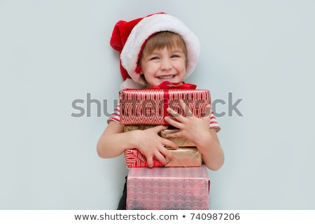 happy little boy with a christmas gift stock photo © alphaspirit