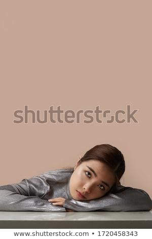 Felice asian donna posa isolato beige Foto d'archivio © deandrobot